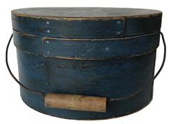 "RM909 19th century New Hampshire Signed Bail Handle Pantry Box with  blue paint ,with over lapping bentwood sides, secured with small copper tacks. The sides of the Box are fitted with a pair of oval stamped tin  handle mounts. Fitted with an arched wire swing handle with wooden hand grips.  11 1/2"" diameter x 6 3/4"" tall"