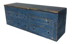 RM332 19th century Pennslyvania store counter Apothecary / set of drawers with a storage compartment on top , circa 1850 with the original blue paint dovetailed drawers ,. measures 36� long 10 1/2� deep 13� tall