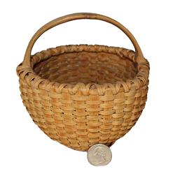 U627 Miniature Basket in great condition,with traces of old yellow and red paint, washed away years ago.  double wrapped rim steamed and bent handle, footed bottom reinforced bottom