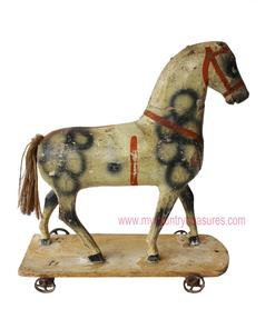 D34 Mid-c1800's Hand Carved Wooden American Pull Toy Horse On Wooden Platform with Wheels. All wheels rotate that are attached firmly to wooden platform. Hand Carved hand painted. Some paint flake and minor peeling original hand paint.