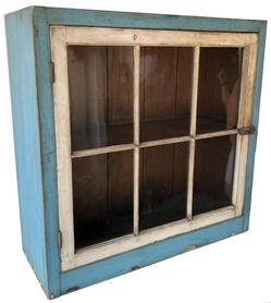 SB2 Early 19th century Burks County Pennsylvania painted pine hanging cupboard, retaining original blue and white painted surface, one single door with six window lites, old wavy glass with a dovetailed case top and bottom