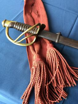RM766 Fantastic American Civil War Cavalry sword with Officers cloth waist sash .  The saber was manufactured by Mansfield and Lamb of Rhode Island and dated 1864.  It is in wonderful  condition and retains its original patina to both the sword and the scabbard.  The leather on hilt  is fantastic!!!!