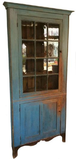 LD3 Early 19th century Corner Cupboard with wonderful old blue paint, nice high scalloped cut out design base which is painted black , the wood is yellow pine, single door with twelve window lites