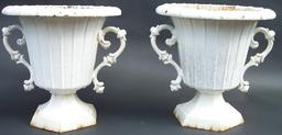 "PM 10 Mid nineteenth early heavy Cast iron urns with elegant handles, found on Nantucket, showing great wear to old white paint. Measurements are:14"" wide x 13 1/2"" tall"