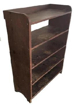 B303 19th century Bucket Bench from south eastern Pennsylvania, with the original dry red paint. The shelves are one board mortised into the one board sides. All square nail construction, circa 1840.