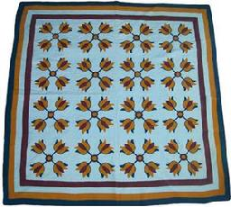 Y109 Lovely vintage Quilt appliqued and stitched by hand. Three shades of pumpkin, brown and blue have been used for the tulip applique's,on a white back ground, very fine stitching was used and the quilt is in very good condition, from a private collection in Baltimore Md.