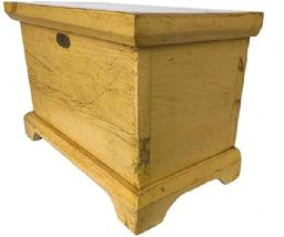 E484 19th centuury York County Pennslyvania diminutive Blanket Chest , in the original yellow paint. Simple applied bracket base as well as a molded lid. Circa 1860