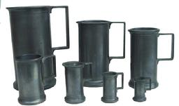 Y68 A set of 7 late 19th century  pewter measures. Graduated set up to a Litre size.  maker's marks