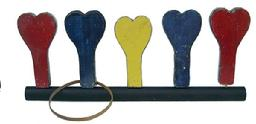 "Z300 Carnival Heart Ring Toss  painted in red, yellow, and blue, these doweled hearts fit into black painted boards and were used for a ring toss game in a mid-century carnival. Some of the hearts were reinforced with strips of sheet metal along their sides, such as these , beautiful color. Measurements 27"" long x 11 1/2"" tall"