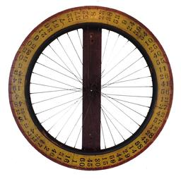 "A312  Vintage Painted Wooden Carnival Game Wheel of Chance. A very unique wheel , made from a wooden Bicycle wheel,  with the original mustard, red and black paint,The wheel is mounted on a board,  for hanging, 31"" diameter x 3"" deep"