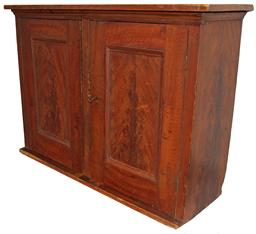 A487 Mid 19th century two door hanging Pennslyvania Cupboard , with original feather grain paint, with two panel doors, full mortised and pinned, with a small applied cove molding on the top circa 1850
