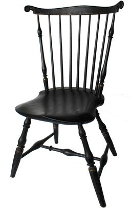 Late 18th century Connecticut gilt-decorated fan-back Windsor side chair in black paint  having serpentine crest rail with carved ears and spindle back above a saddle seat on vase-turned legs joined by a recessed stretcher.