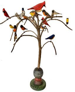 "D505 American, 20th CenturyFolk Art Bird Tree, with twenty one  beautiful polychrome painted and hand  carved wooden Birds  resting on a steamed and bent branchs resting on a colorful base 24"" tall"
