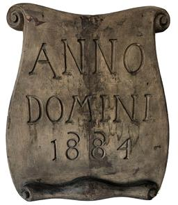 E285 19th Century Scroll shaped and deeply carved wooden building sign inscribed with:  �Anno Domini 1884�.  (Latin for: �Year of our Lord� � which was later abbreviated as A.D.) Sign is constructed of pine wood with cut nails and retains its original weathered and faded gold painted surface