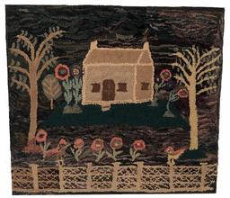 E51 Early New England Hooked Rug depicting a house with grassy yard, several trees, beautiful flowers and two oversized birds perched upon an elaborate fence which stretches along the length of the foreground.