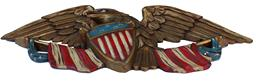 C362  Carved, Gilded, and Painted Federal Eagle Wall Plaque, possibly , Boston, Massachusetts, c. 1950, with American flags flanking the spreadwing eagle, its talons clutching an American shield, ht. 11 1/2, wd. 1/2, lg. 30