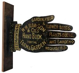 Rawson & Co 34 South Market Street Boston Mass.imports  and growers of Garden , field & Flower seed. This sigm is painted on tin in the shape of a hand the back ground color is black with white lettering, it is made to hang, two sided excellent condition circa 1880's