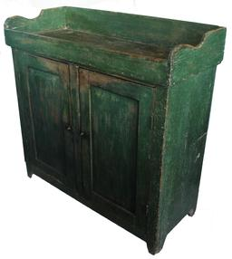 JR7 19th century Eastern Shore Maryland Drysink with the original green paint, applied The doors single panel that are mortised and pegged. Dovetailed gallery, and ddovetailed well,