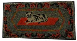 Y217 An outstanding example of American folk art, This hooked rug features a princely Tabby cat on a red rug, A floral garland surrounds the cat,