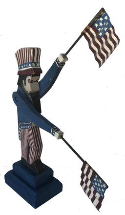 RM1016 Patriotic Uncle Sam Folk Art Whirl gig holding two Flags 22� from top of hat to base