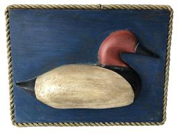 RN889 Plaque decoy from Talbot County Maryland, Canvasback drake decoy carved by Carlton Harris mounted on board with rope border. 16� wide 12�tall