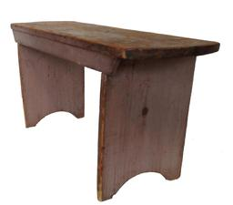 19th century Bench found in Chester County, Pennsylvania in early taupe paint. The top has rounded ends and an applied apron across the front.  The legs are double mortised through the top with a nice half circle cut out on bottom of each leg.  Bench is very sturdy as it is also reinforced with early handmade cut nails.  Measurements are: 36� wide x 11 1/2� deep x 17� tall.