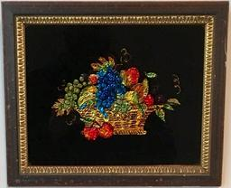 E43 Beautiful framed Tinsel painting of a Basket of Fruit that includes two kinds of grapes, cherries, pear, apple, plums, lemon, strawberry and bananas. As printed on the back: �Tinsel Painting is a form of primitive art done by young ladies from colored tinsel paper. The art enjoyed its greatest popularity from 1825 � 1875.  Ruth Voliman�   Tinsel paintings are reverse paintings on glass with smooth or crumpled metallic foil applied behind translucent and transparent areas causing the effect of shimmering highlights when viewed in candlelight or gaslight. This would be an excellent addition to a collection of Theorems or Reverse Paintings.