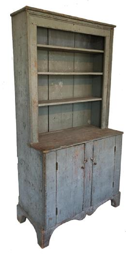 E78 Early 19th century New England open top Stepback Cupboard , with the old blue over the original red, with plate rail on shelves, picture frame molding around opening of top shelves, Double drop apron in front, nice high cut out feet on sides