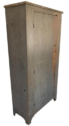 (G78) Early 19th century Lancaster County Pennslyvania, one door storage Cupboard/ Pantry The best old dry gray over the original robin egg blue painted surface . Single plank door with two large batons, high shaped cut out feet., finished off with a simple molding at the top. circa 1820