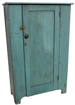 B419 19th century Pennsylvania one door storage Cupboard in the original robin egg blue  paint,  paint, all original, interior natural patina, one door construction, the door is mortised and pegged ,  nice cut out foot, single panel door circa1820 - 18