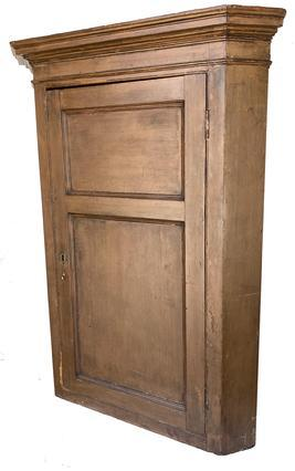 F503 18th century Hanover, Pennslyvania hanging Corner Cupboard, with the original nutmeg paint, with a two panel full mortised door, with tall applied molding, the wood is white pine, the back boards are held in place with rose head nails