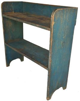 "D411 Early 19th century Pennsylvania Painted pine bucket bench, retaining its original blue  surface, The shelves are mortised into the side with two braces on back mortised into the shelf, high arched cut out feet , beautiful wear to the shelves   Measurements are 37 1/4"" h., 36"" w."