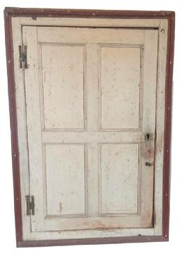 O189 18th century New England hanging corner cupboard with original oyster white and red paint. Very unusual interior with butterfly shelves and a drawer below. The door is full mortised and pegged construction with brass � H � hinges.  measurements: 45� tall 30� wide and will fit a 23� corner