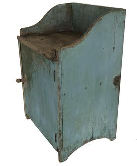 "Early 19th century small Wash Bench form Eastern Niorth Carolina, with old robin egg blue paint, one single door with two dovetailed batons to keep he wide single board from cupping, with the original turn knob. One board construction, original cast hinges, circa 1820  Measurements are 19 7/8"" wide x 16 1/4"" deep x 30 3/4"" tall"