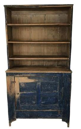 E159 Mid 19th century open top Stepback Cupboard from Shenandoah Valley Virginia, in the original indigo blue paint with natural patina on the interior with three shelf's, over a single door with a bible cross panel door.