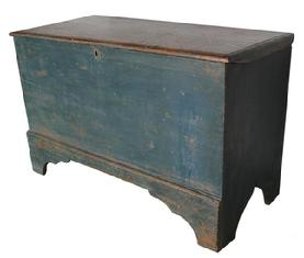 C20Early 19th  century New England Blanket chest with the original blue paint, nice high cut out foot. applied molding around the lid
