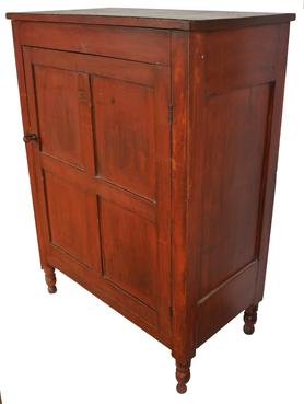 "D179  Early 19th century Lancaster County Pennslyvania four panel door Cupboard,in the original red paint, resting on four Sheraton turned feet. single panel on each side, with two  chenfered panels in the back . Original turn knob and hardware, the wood is poplar and cheery circa 1820-18230 Measurements are 20"" deep x 37 1/4"" wide x 50 1/2"" tall"