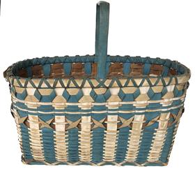 E533 Native American Indian Maine Penobscot Ribbon Blue and White Paint Decorated Basket Woven in a oval  form with curling ( X) ribbons in center with blue and white ribs.Basket features a tall notched handle.measures 15 1/2� tall  17 1/2� long 10� wide