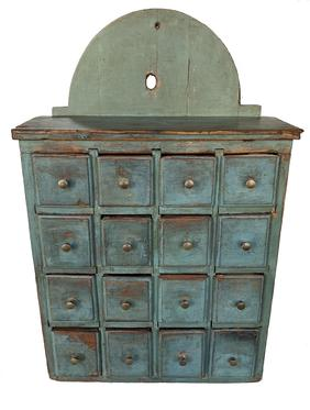 "F293 Late 18th century Pennsylvania sixteen drawer Spice Cabinet, in beautiful blue paint high arch tombstone�s back, with a dovetailed case and tee nailed drawers, molded edge drawer front the dividers are mortised into the case,  24 1/2"" high ., 15 1/4"" wide ."
