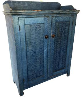 E250 Gorgeous Chester County, two door storage cupboard with blue paint decoration. Applied splayed and shaped  dovetailed gallery. Clean natural interior nice high cut out foot, solid ends Beautiful   c. 1820Pine  Ht. 55 1/2� W. 43 1/2�  D. 17 3/4�