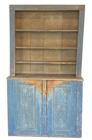 F177Early 19th century Maine Stepback Cupboard which is two parts, open top over two raised panel doors showing wonderful wear to the paint and doors. Circa 1820