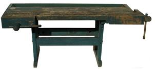 "Late 19th century  Work Bench of mixed woods, the long, thick top set with a rear trough,, and two vises, each having wood screws, one showing hand dovetailed joinery, raised on shoe foot end pieces, 31""h, 84""w, 33""d"