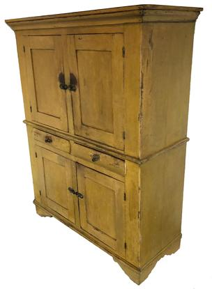 "D264  Mid 19th century Unusual Pennsylvania painted pine cupboard,Linen Press  retaining the original yellow paint, two panel doors over two dovetailed drawers, over two panel doors, applied molding to a dovetailed case, beautiful applied cut out base, center waist molding circa 1840  very unusual size  , 58 1/2"" high ., 45 1/2 "" x 18 1/2"" deep"