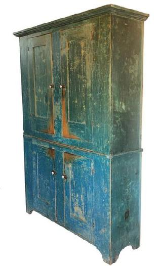 F13 A fine and unusual 19th century York County Pennsylvania flat wall storage cupboard retaining it's original blue paint, Four mortise and tenon joined and pegged paneled doors, opening to a shelved light mustard-painted interior, high shaped cut-out feet with an applied molded top. Circa 1820-1840