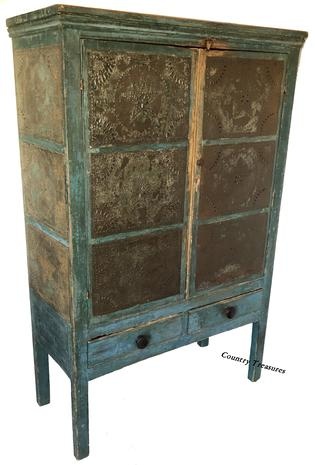 "D517 Early 19th century twelve star tin Pie Safe, from Western Maryland, in the original blue paint, two  doors,over  two drawers, the tins are all hand punched, circa 1820 Measurements are  16 1/4"" deep x 37 1/4"" wide x 56 1/2"""