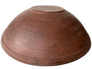 F322 Late 18th century New England original dry red painted large Beehive wooden bowl . It is out of round, Bold form, with broad inner rim tapering subtly downward, showing strong evidence of slow lathe turning,.