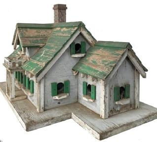 F98 Early 20th century South Carolina Folk Art Carved and Painted two Story Bird House Circa 1920. with eleven compartment. A lot of detail and workmanship with into making the Bird House