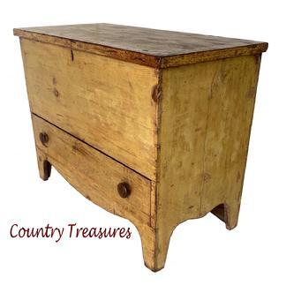Mid 19th Century Western Pennsylvania Chest over Drawer � or �Mule� Chest � in original yellow paint with one dovetailed drawer, beautiful high cut out feet. The case is all square head nail construction with two wide boards for the back and applied molding around the top. The inside is very clean. The primary wood is white pine with the secondary wood in the drawer being chestnut � indicative of the Western Maryland and Pennsylvania region.   The chest retains its original lock, however the key is missing.  Very unusual to find a Mule chest in this appealing color and size! Measurements: 38 1/4� wide x 18 3/4� deep x 29 1/2� tall