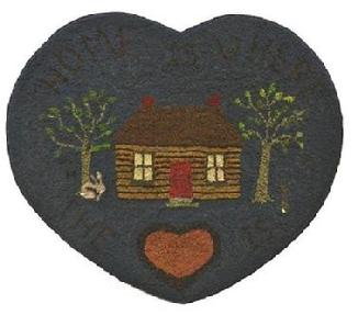 "Y51  Early 20th century,Heart Hooked Rug , from Maine, mounted on board, great colors, of cabinn with rabbits, and large hearts. Measurements are: 31"" tall  x  36 1/2"" wide"