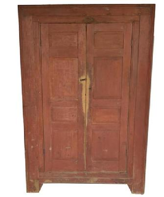 X388 18th century Wall Cupboard with two raised four panel doors. Front of the Cupboard has molded perimeter and is recessed again to the door, small bracket feet